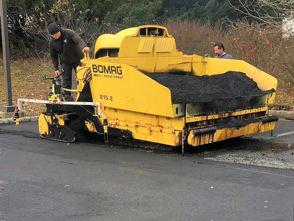 Titan's Specialized Paving Equipment with Automated Grade Control
